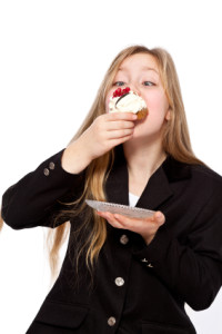 Girl eating pastry